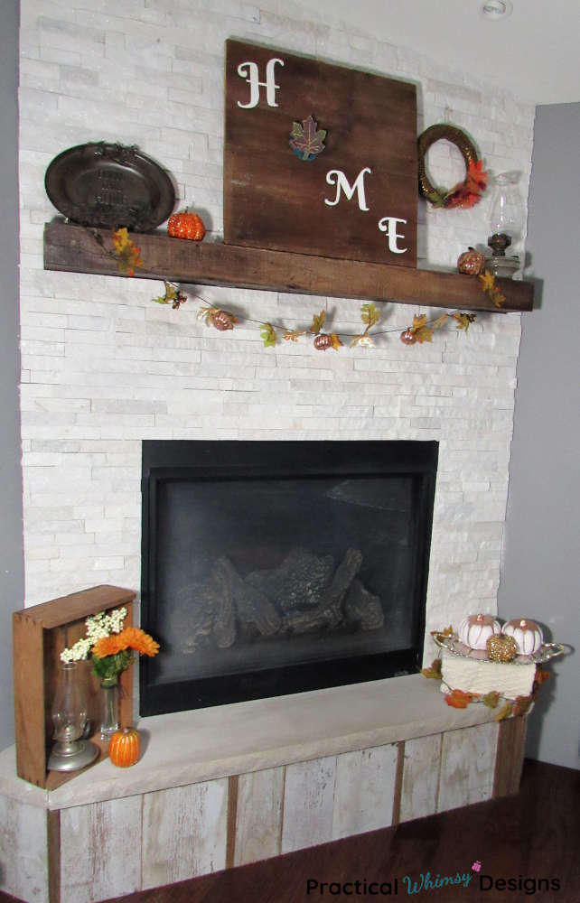 Fall mantel decor: rustic wood signs, pumpkins, and wreaths