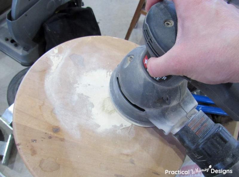 Sanding putty off table with random orbital sander.