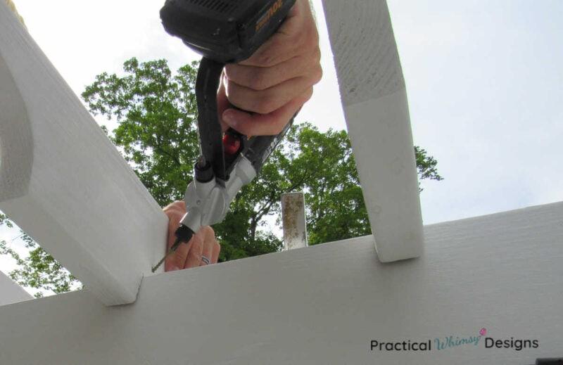Drill screwing pergola rafter onto beam.