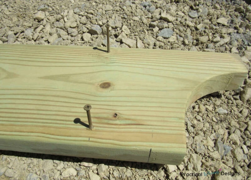 Board with screws in it ready for attachment.