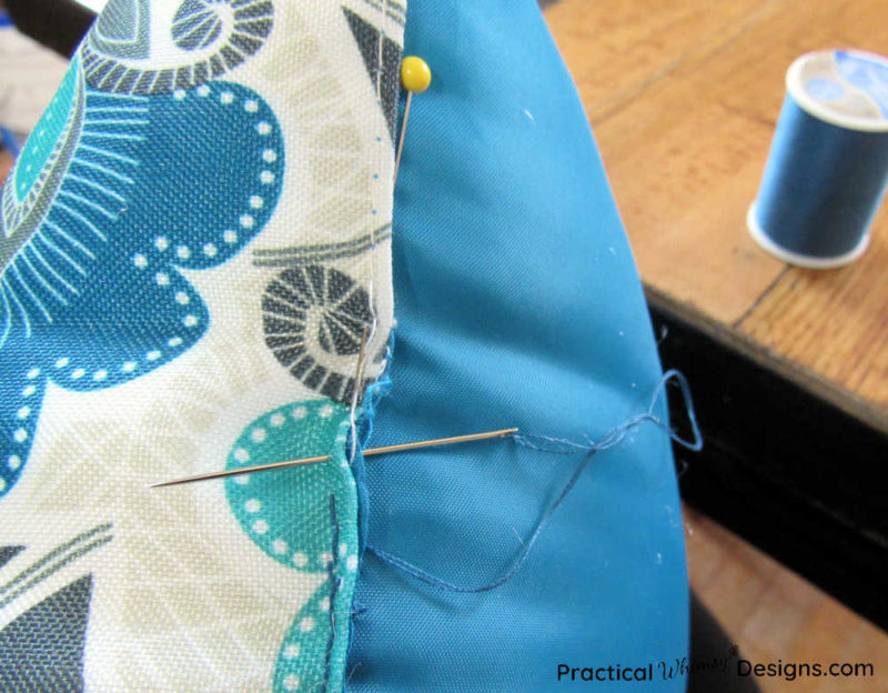 Sewing seam closed on pillow.