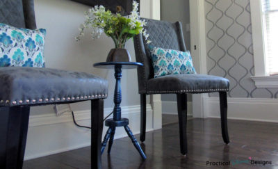Painted Side Table Makeover with flowers and a vase sitting on it