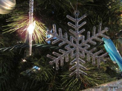 Snowflake ornament on tree