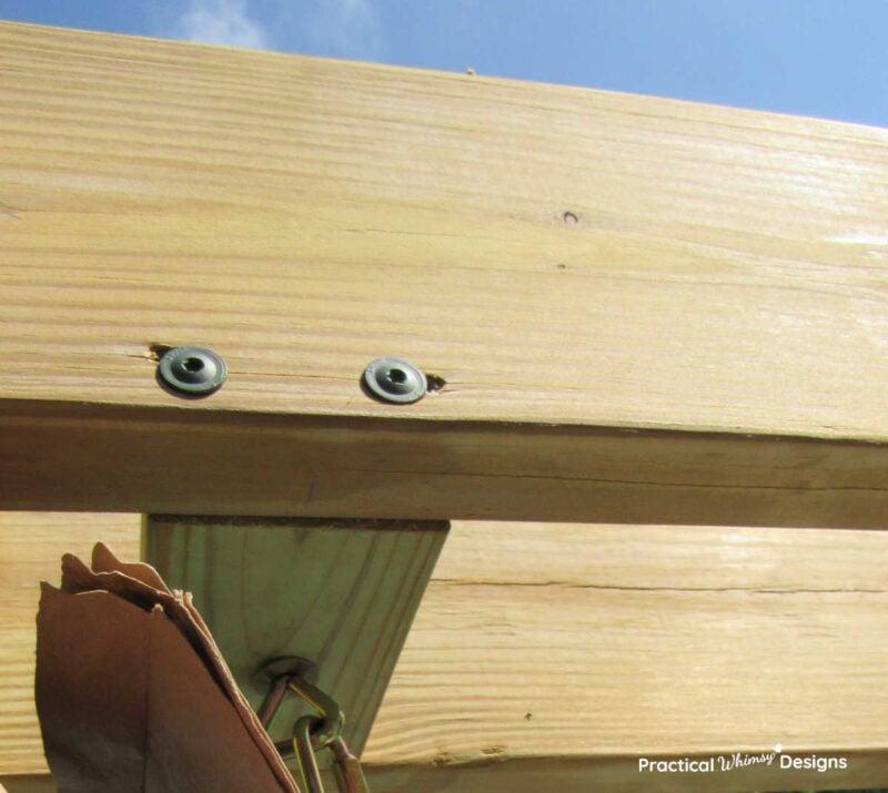 Spax screws holding block for diy wood pergola swing.