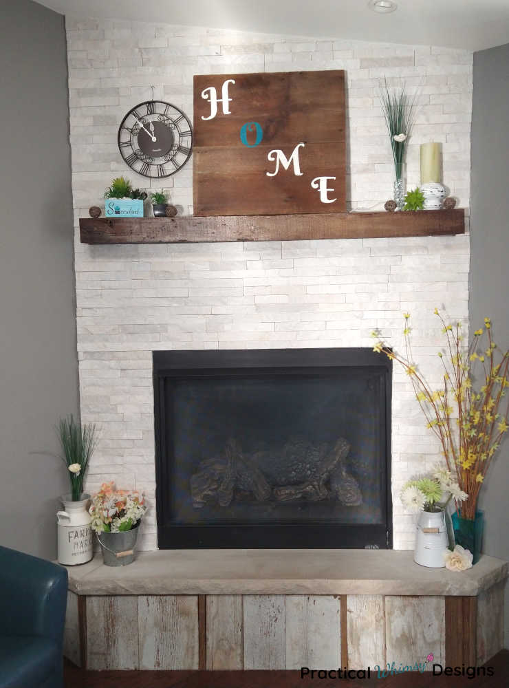 Spring decor on fireplace mantel and hearth.