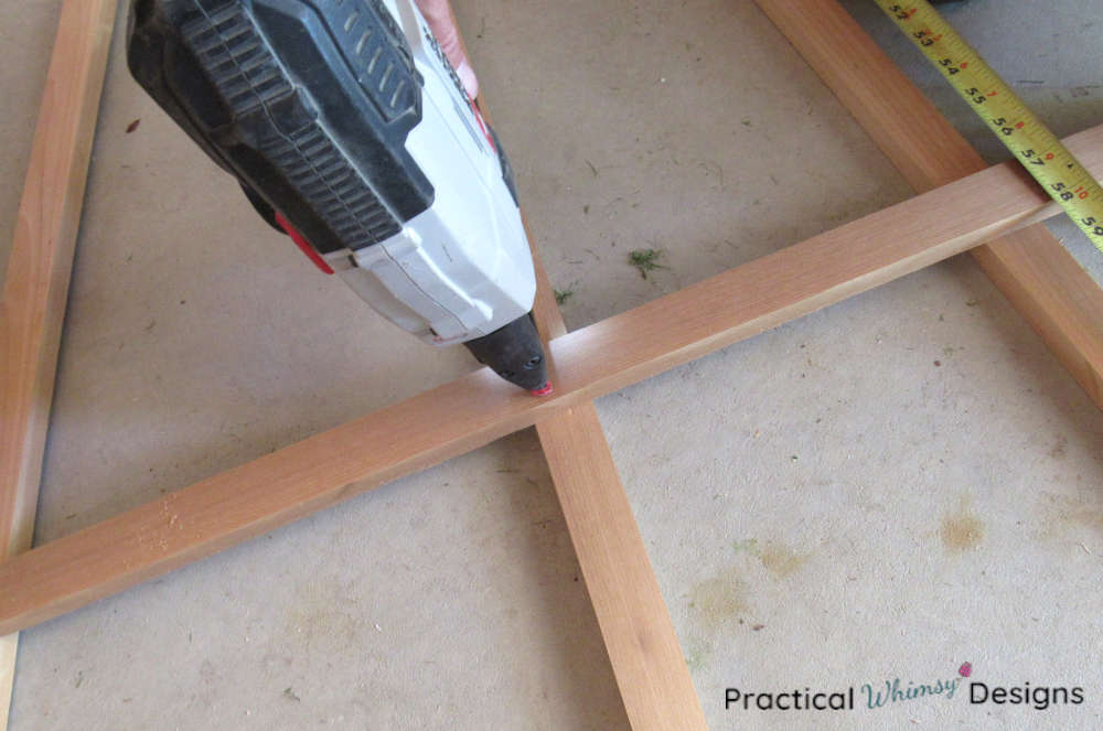 Stapling trellis boards together with a crown stapler.