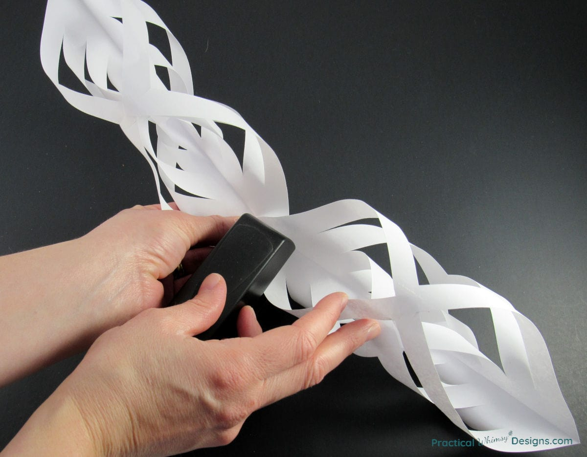 Stapling two pieces of the star together.