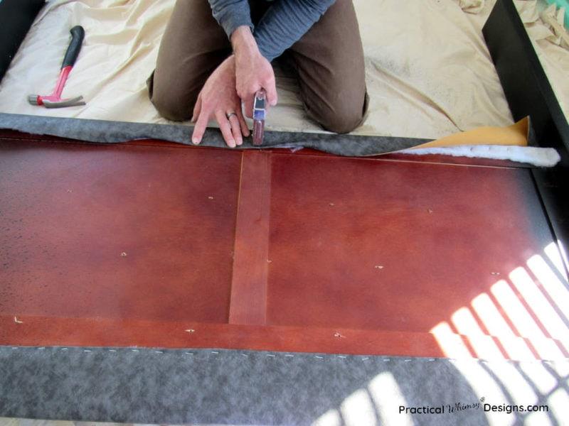 Stapling fabric to  DIY fabric headboard