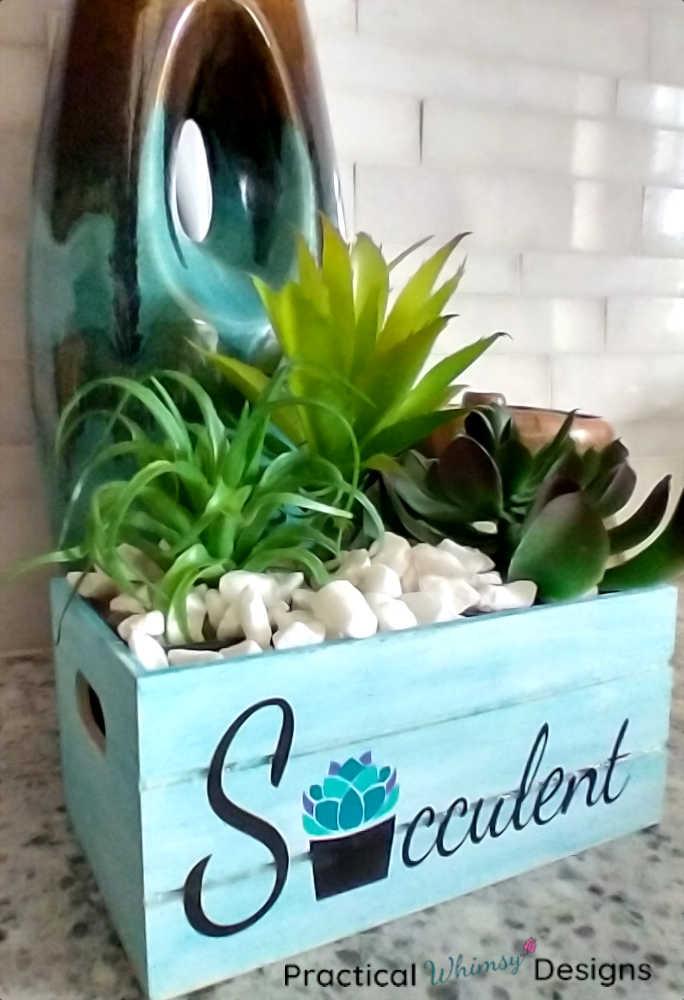 Succulent planter next to vase in kitchen