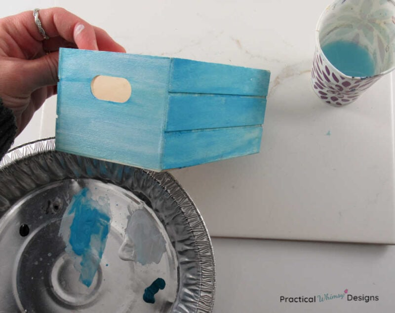 Blue acrylic paint on box