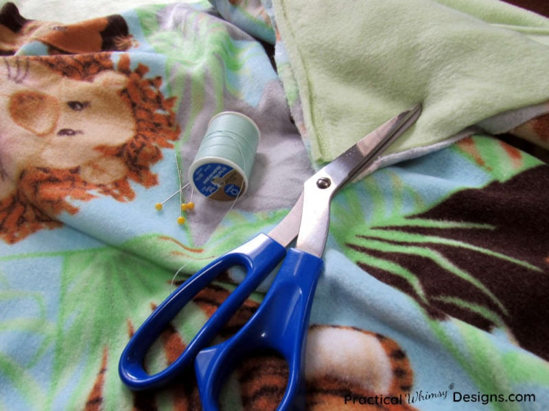 Supplies for how to make a fleece blanket