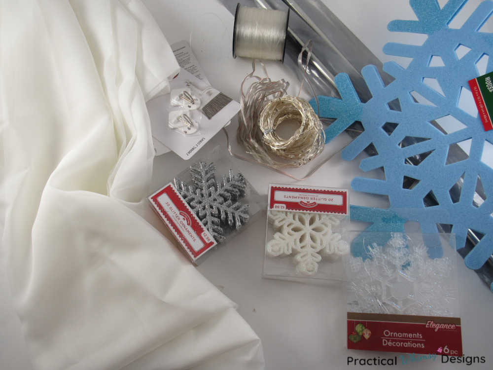 Supplies for making a snowflake lighted curtain