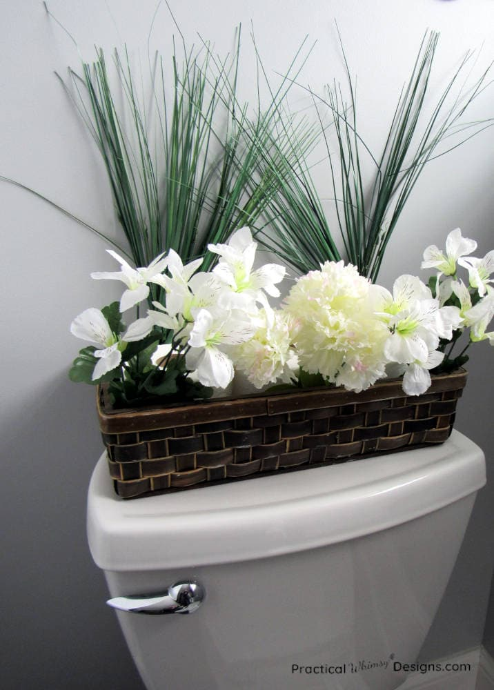 Toilet paper in a basket with flowers