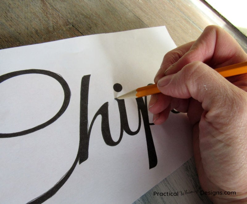 Transfer word onto wood with chalk and pencil