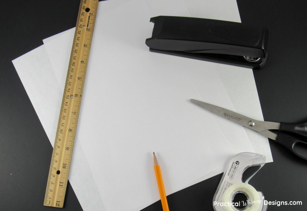 Twisted Paper Star Supplies: ruler, tape, stapler, scissors, paper, and pencil.