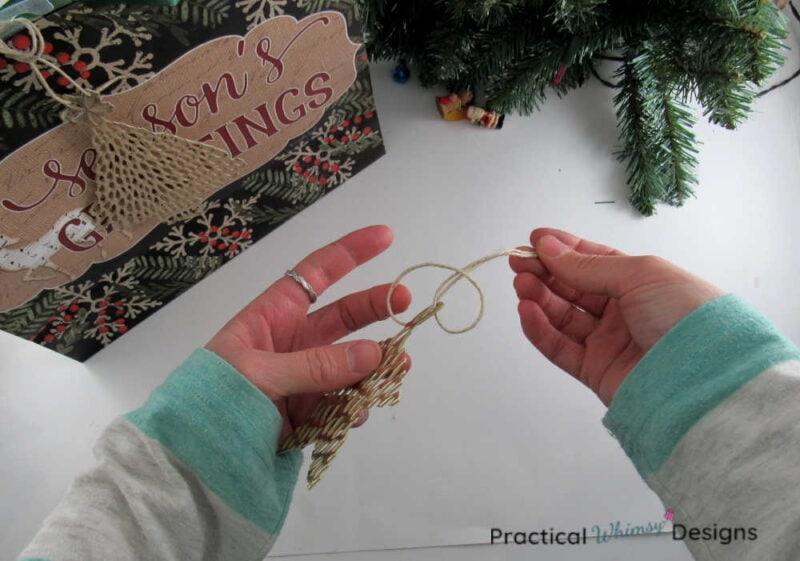 Tying hemp cord onto ornament.