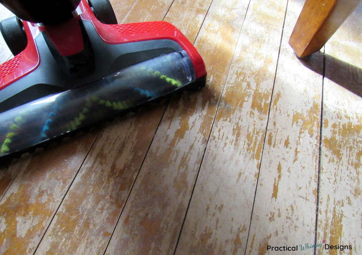 Red vacuum on hardwood floor