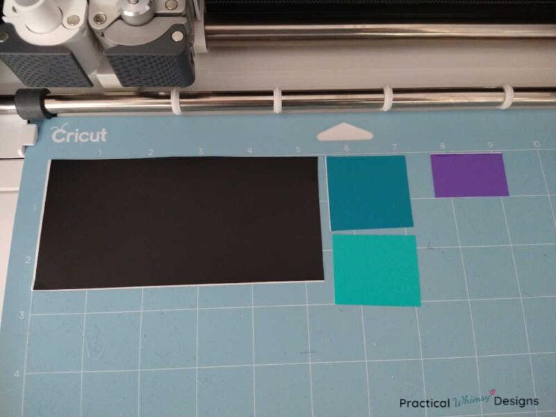 Vinyl on Cricut mat next to cutting machine