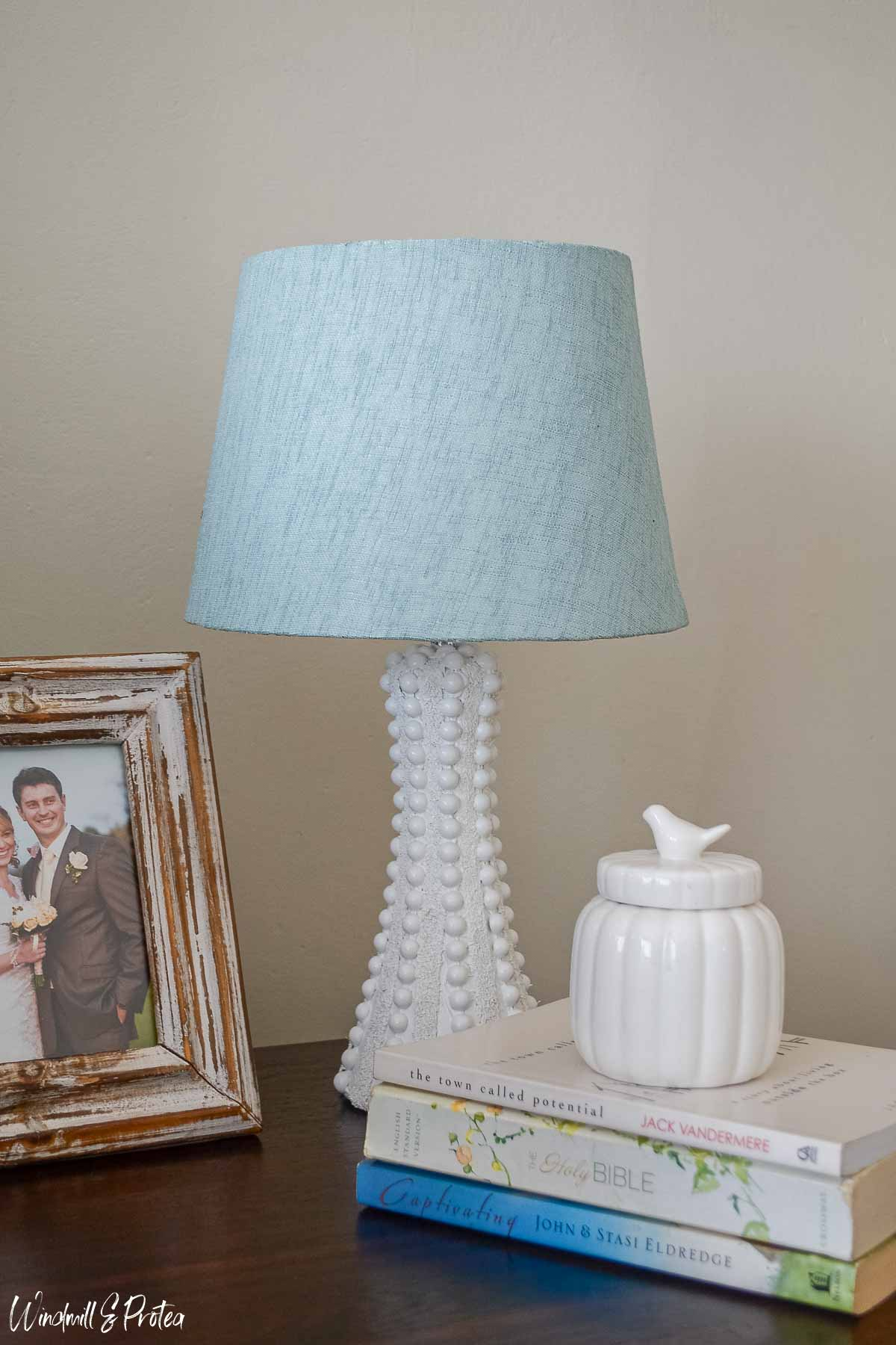Hobnail table lamp, books and picture