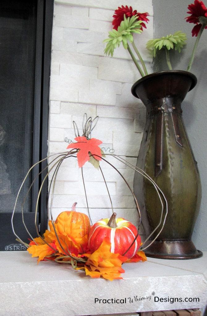 Wire pumpkin on mantel