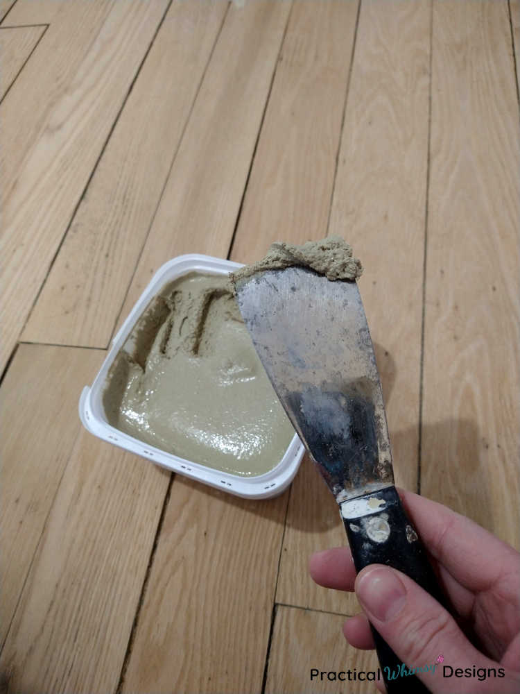Wood filler on a putty knife