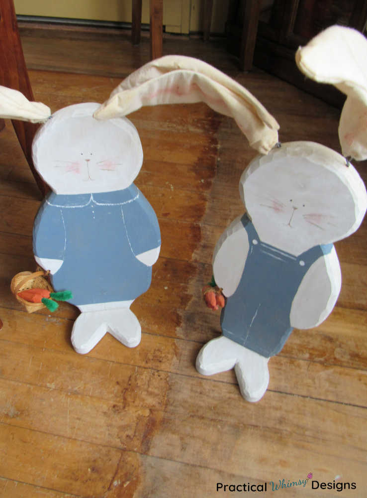 Large wooden bunny decor with blue painted clothes