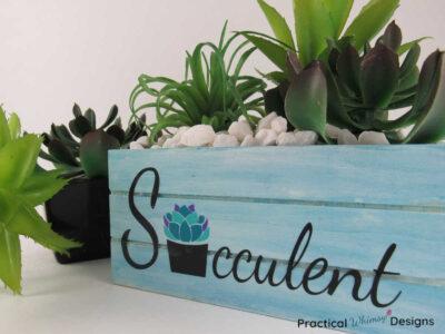 Blue succulent planter box diy with succulents plants and white rocks
