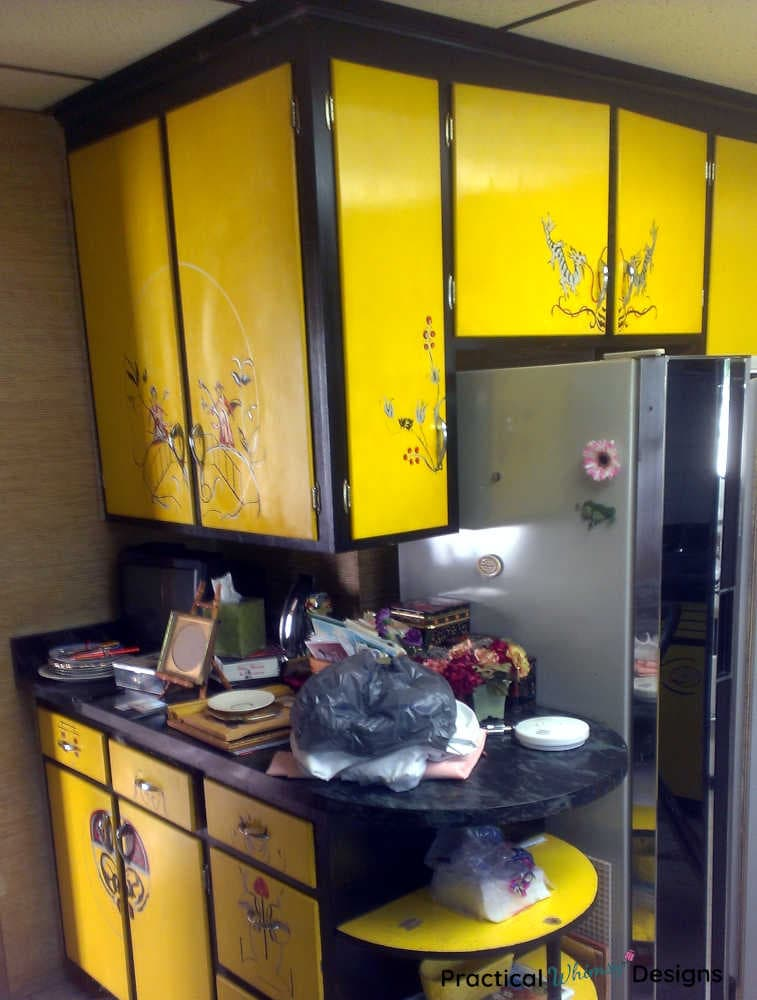 Lemon yellow and black oriental cabinets in kitchen