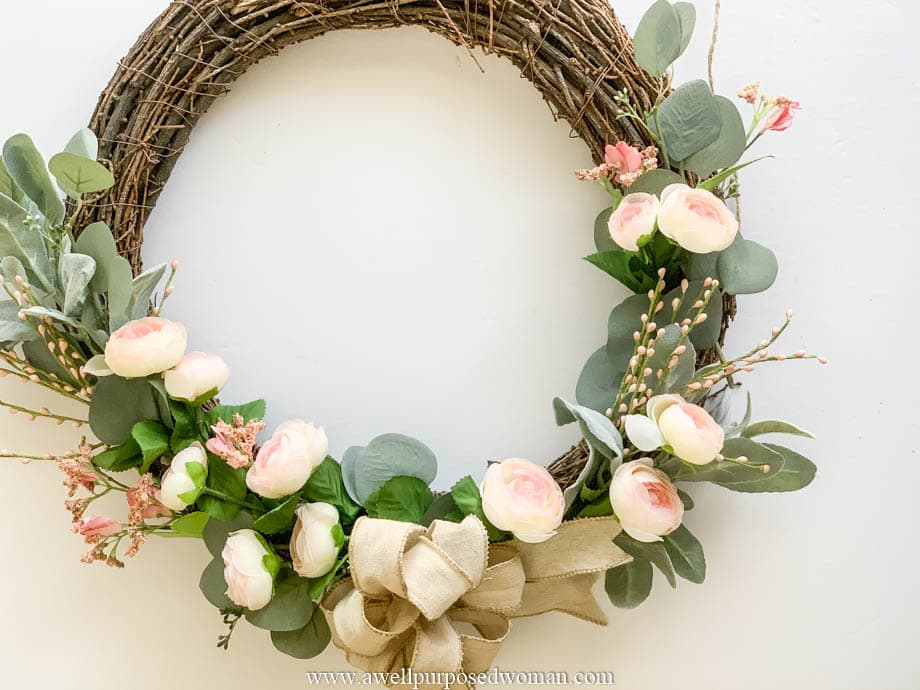 Spring grapevine wreath with pink flowers